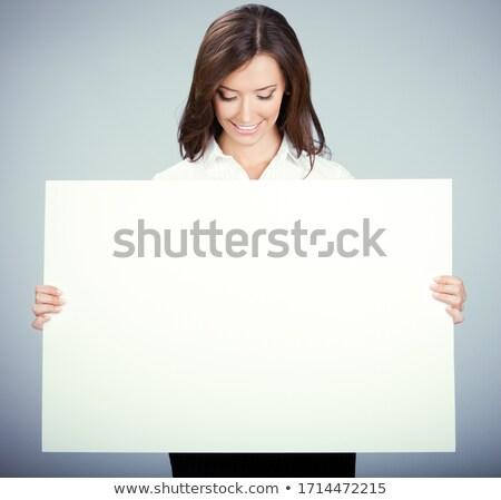 女性 · 執行 · ポインティング · ブランクカード · オフィス · 肖像 - ストックフォト © wavebreak_media