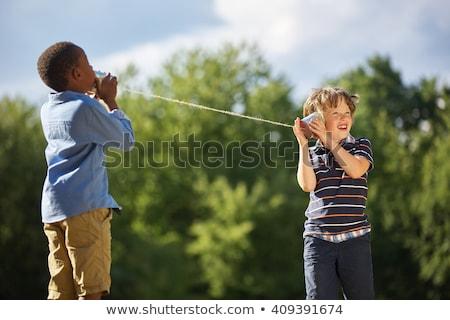 Сток-фото: Friendly Child Listening To Tin Can Phone