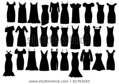 smiling woman in little black dress on white stock photo © stepstock