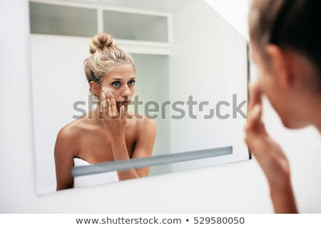 Woman getting makeup applied on her body Stock photo © stockyimages