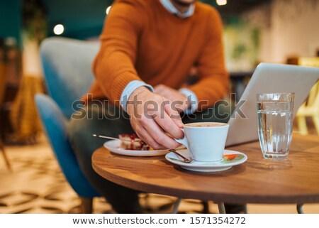 Yakışıklı işadamı çalışmak dizüstü bilgisayar restoran Stok fotoğraf © jakubzak