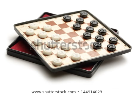 Travelling draughts or checkers on playing field Stock photo © stevanovicigor