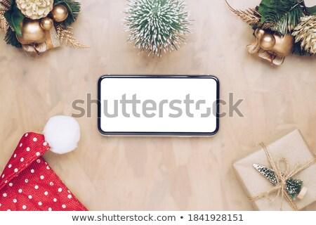 Modèle Noël cadeaux téléphone une femme Photo stock © pxhidalgo