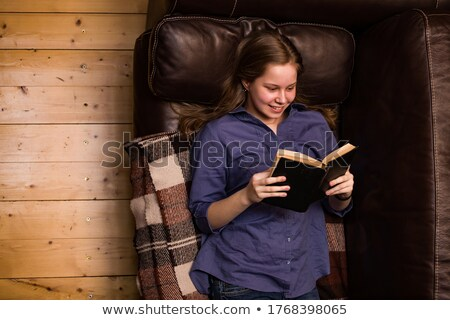 Teen girl relaxing in leather recliner Stock photo © jarenwicklund
