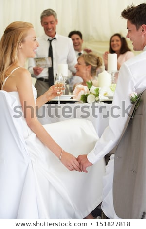 Stock fotó: Bride And Groom Listening To Speeches At Reception
