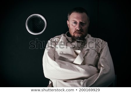 Insane man in the hallway wearing a straitjacket Stock photo © sumners