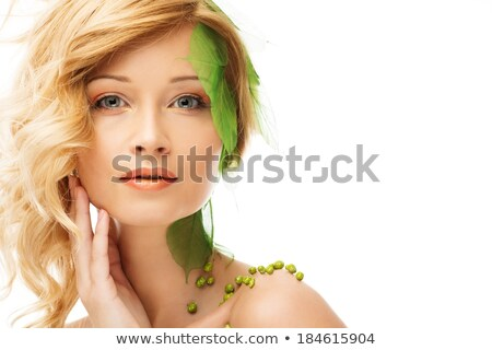 beautiful young woman in conceptual spring costume touching her face stock photo © nejron