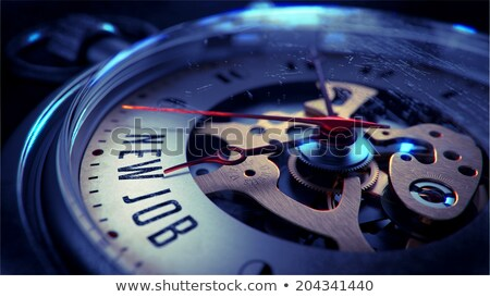 new job on pocket watch face stock photo © tashatuvango