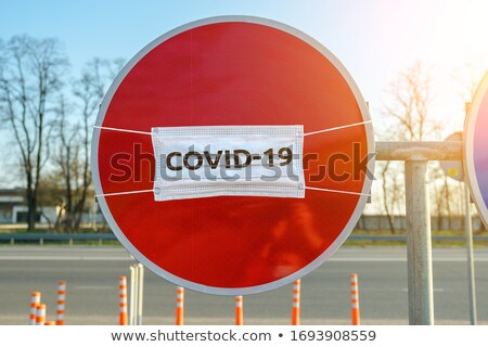 virus inscription on warning road sign stock photo © tashatuvango