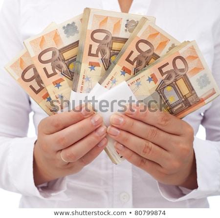 Nő tart ötven eurók boglya Euro Stock fotó © stevanovicigor
