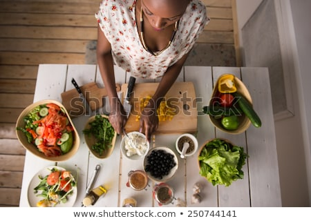 Young African Woman Cooking Salad Stock photo © HASLOO