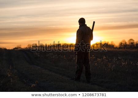 ストックフォト: ハンター · 日没 · 実例 · 男 · 自然 · シルエット