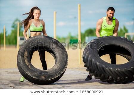 fitness girl with two tyres Stock photo © kokimk