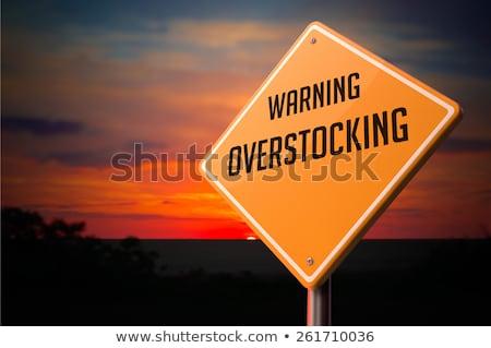 Overstocking on Warning Road Sign. Stock photo © tashatuvango