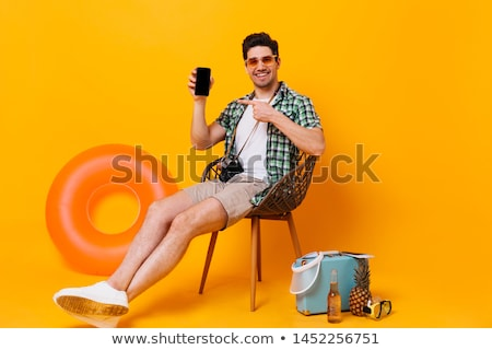 Optimistic Man on a Chair Looking at the Camera Stock photo © ozgur