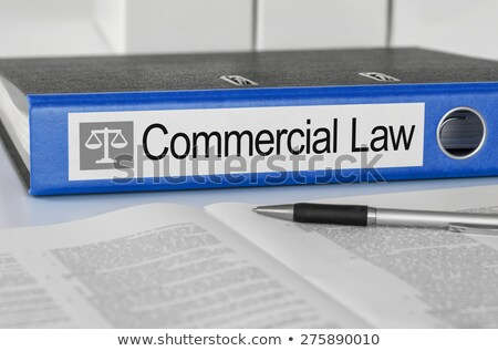 Blue folder with the label Commercial Law Stock photo © Zerbor