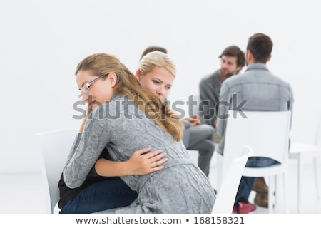 group therapy session with therapist and client hugging stock photo © wavebreak_media