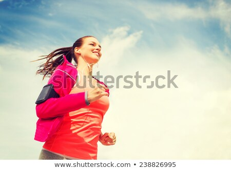 happy sports woman with smartphone stock photo © deandrobot