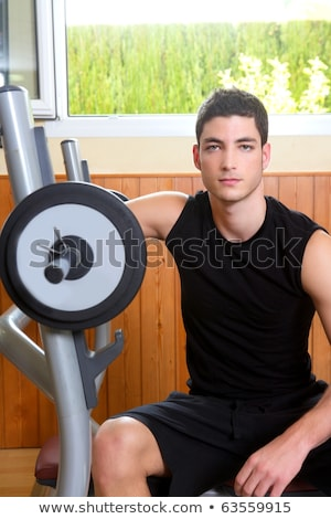 Gym young man posing bodybuilding weigths Stock photo © lunamarina