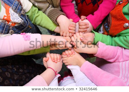 Children stand around having joined hands,  top view Stock photo © Paha_L