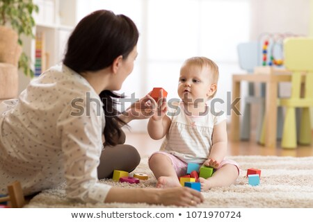 family with baby and building Stock photo © Paha_L