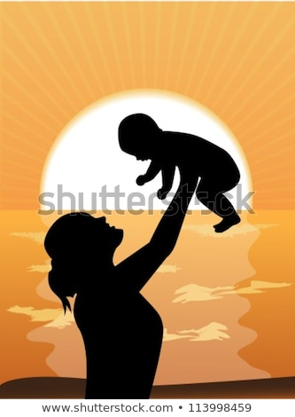 Stock fotó: The Silhouette Of Mother With The Child Against The Background Of The Sunset