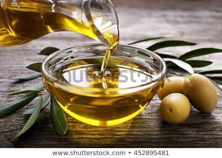 Extra aceite de oliva vintage vidrio jar aceitunas Foto stock © marimorena
