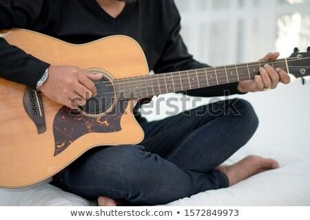 Funny młody człowiek śpiewu gry gitara elektryczna długie włosy Zdjęcia stock © deandrobot