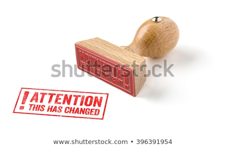 A rubber stamp on a white background - Attention this has change Stock photo © Zerbor