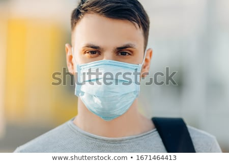 Young man with a mask on his face Stock photo © zurijeta
