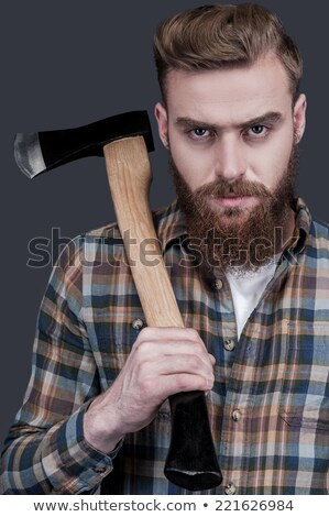 Young bearded man with big axe looking at camera Stock photo © deandrobot