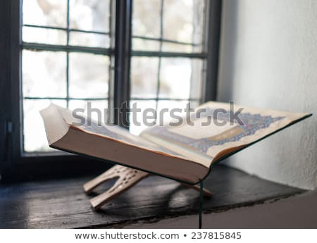 old koran book on window shelf stock photo © zurijeta
