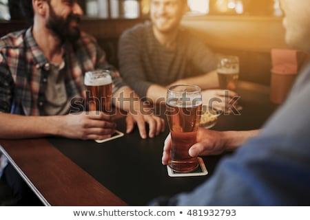 Amigos potável cerveja bar pub Foto stock © dolgachov