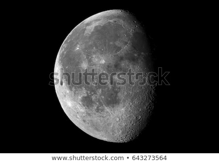 Stock photo: Moon in waxing gibbous phase on a black background