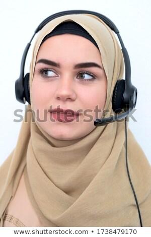 female call centre operator with headset isolated on white backg stock photo © nikodzhi