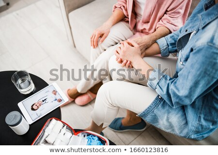 Senior caucasian doctor holding tablet computer. Stock photo © RAStudio
