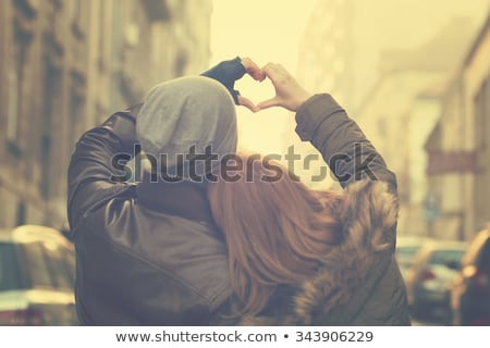 Young couple in love, hugging on the street. Stock photo © tekso