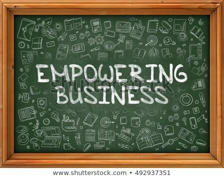 empowering business   hand drawn on green chalkboard stock photo © tashatuvango