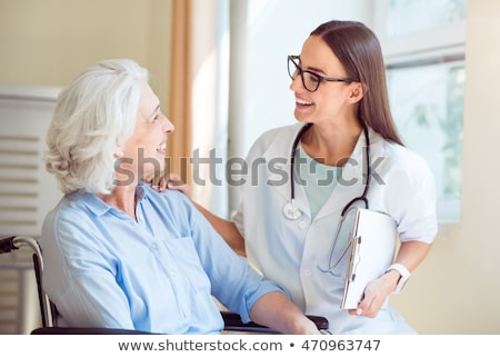 Nurse talking to patient Stock photo © IS2
