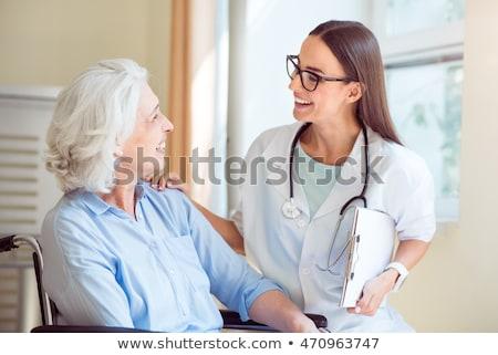 orvosok · megvizsgál · beteg · asztal · nő · orvosi - stock fotó © is2