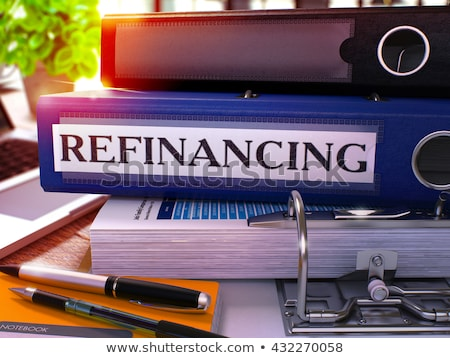 Refinancing on Blue Ring Binder. Blurred, Toned Image. Stock photo © tashatuvango