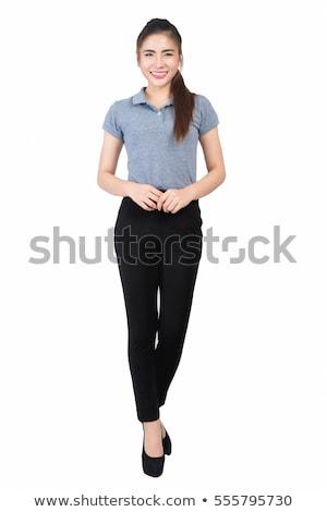 Fashion model wearing grey pants and white shirt Stock photo © DenisMArt