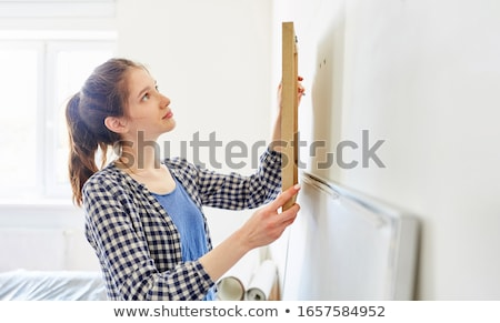 woman hanging up a picture Stock photo © IS2