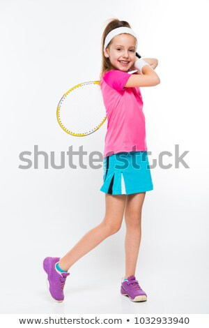 Cute little girl with tennis racket in her hands on white background Stock photo © Traimak