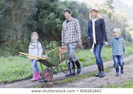 Aile el arabası kir yol yol adam Stok fotoğraf © IS2