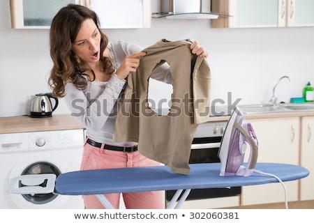 Сток-фото: женщину · глядя · ткань · Постоянный · совета