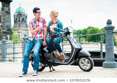 Tourists on a scooter trip taking rest on the Musuem Island Stock photo © Kzenon