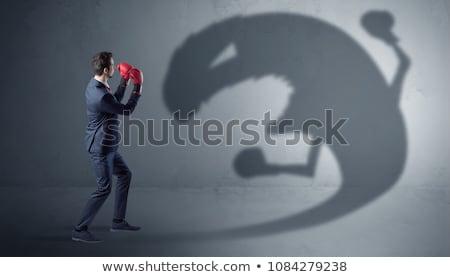 üzletember harcol nagy szörny árnyék boxkesztyű Stock fotó © ra2studio