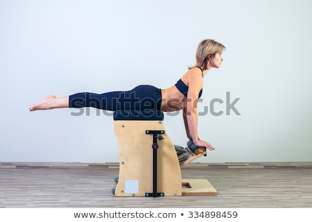 pilates · silla · mujer · fitness · yoga - foto stock © lunamarina