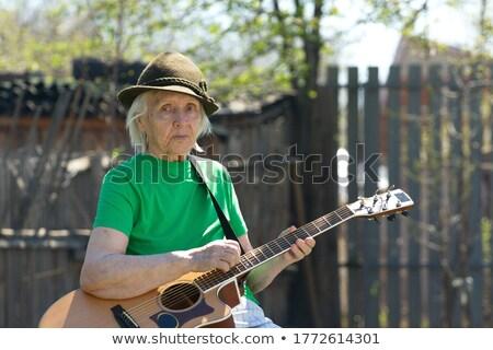 green shirt old women_classic music Stock photo © toyotoyo
